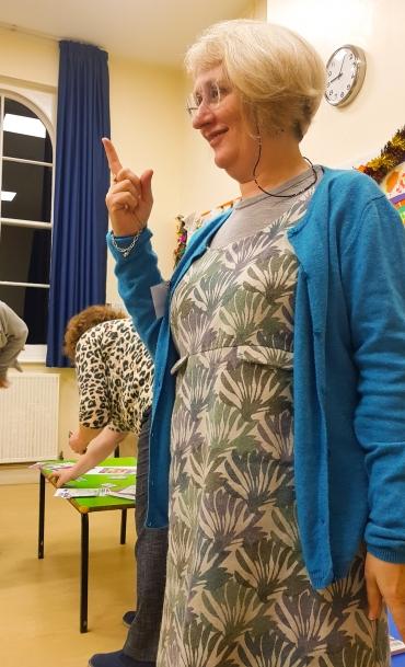Gill playing charades